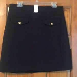 Black skirt with gold buttons